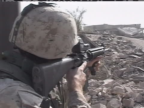 an american soldier aims his rifle through the rubble in iraq. - (war or terrorism or election or government or illness or news event or speech or politics or politician or conflict or military or extreme weather or business or economy) and not usa stock videos & royalty-free footage