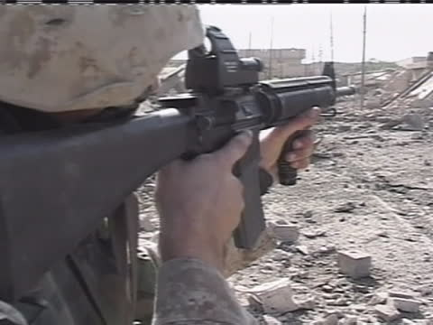an american soldier aims his weapon through rubble in iraq. - (war or terrorism or election or government or illness or news event or speech or politics or politician or conflict or military or extreme weather or business or economy) and not usa stock videos & royalty-free footage