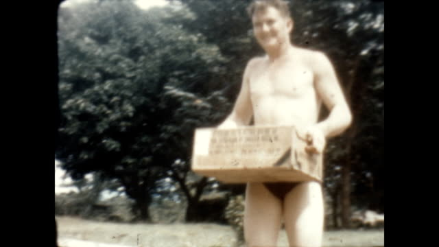 an american soldier carries a case of beer local filipina women join american gi's at the swimming hole near clark air base - luzon stock videos & royalty-free footage