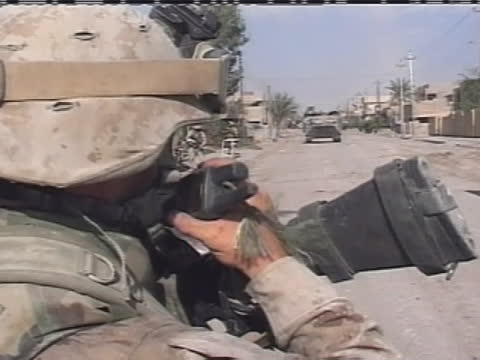 an american soldier gives directions by radio in iraq. - (war or terrorism or election or government or illness or news event or speech or politics or politician or conflict or military or extreme weather or business or economy) and not usa stock videos & royalty-free footage