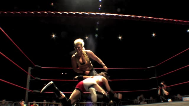 An American style professional wrestling match sequence between 2 women
