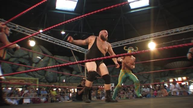 vídeos y material grabado en eventos de stock de an american style professional wrestling match sequence featuring a masked mexican luchador - oficial deportivo