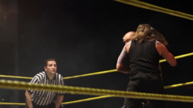 an american style professional wrestling match sequence - 英国ハンプシャー点の映像素材/bロール