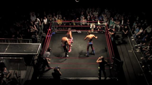 vídeos y material grabado en eventos de stock de an american style professional wrestling tag match sequence - oficial deportivo