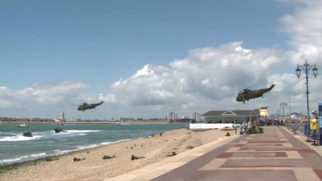 an amphibious vehicle roared off a landing craft onto a beach at this naval port on thursday in a demonstration to mark the 70th anniversary of d day - amphibious vehicle stock videos & royalty-free footage