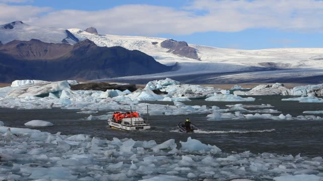 an amphibious vehicle with tourists at the jokulsarlon ice lagoon which is one of the most visited places in iceland. it has been created by the... - tourism stock videos & royalty-free footage