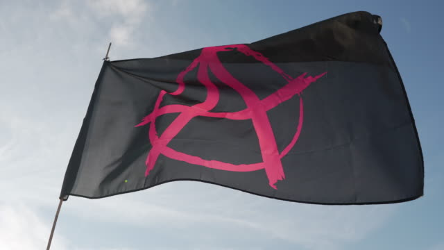 an anarchy flag blowing in the wind - politics background stock videos & royalty-free footage