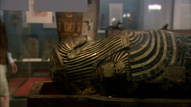 an ancient egyptian sarcophagus lies on a table. - coffin stock videos & royalty-free footage