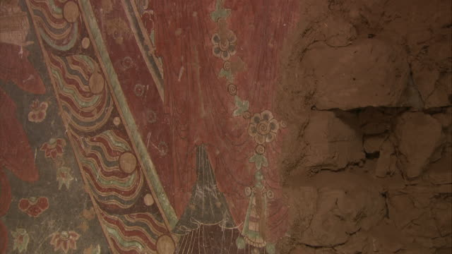 an ancient mural of buddha's image is on the wall in cave number 15 in bezeklik in xinjang uyghur autonomous region silk road china - ancient stock videos & royalty-free footage