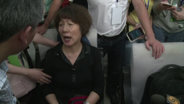 An angry relative of victims of the Chinese sunken ship breaks into an official press conference to demand the authorities investigate the reasons...