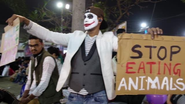 an animal activist the the joker mask take part in a campaign to stop killing animals, during kolkata international book fair, february 9 kolkata,... - killing stock videos & royalty-free footage
