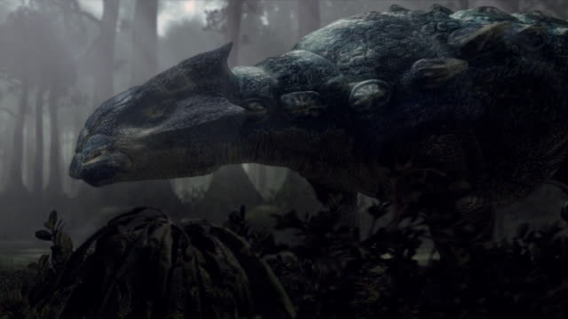 An Ankylosaurus forages in a forest in a computer generated animation.