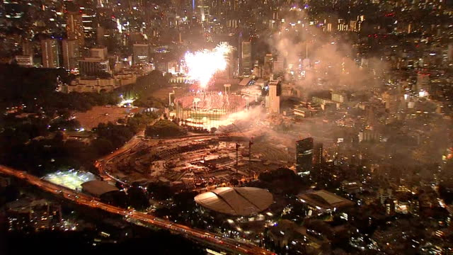 an annual fireworks extravaganza on aug 20 dazzled crowds and lit up the construction site where the new national stadium for the 2020 tokyo olympic... - summer olympic games stock videos and b-roll footage
