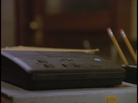 an answering machine with a blinking light  sits on a desk. - blinking stock videos & royalty-free footage