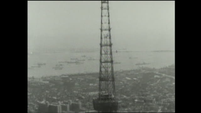 an antenna tops the steel frame of the tokyo tower. - 1958 stock videos and b-roll footage