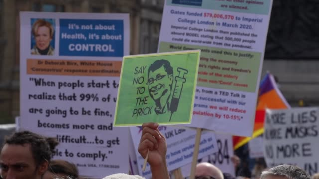 """an anti vaccination protest banner against bill gates as demonstrators attend a """"we do not consent"""" anti-mask rally at trafalgar square on september... - banner sign stock videos & royalty-free footage"""