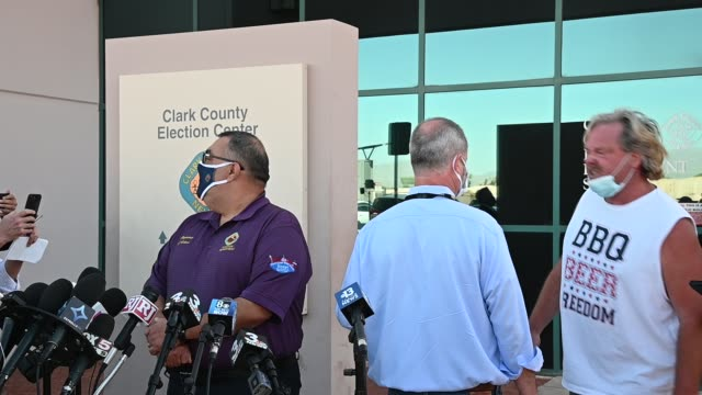 """an anti-biden demonstrator wearing a """"bbq beer freedom"""" shirt interrupts clark county registrar of voters joe gloria as discusses ballot counting at... - counting stock videos & royalty-free footage"""
