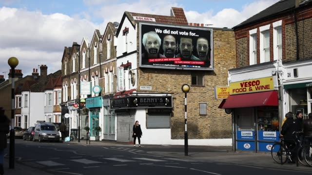 An AntiBrexit billboard commissioned by the 'stopthesilence' campaign hangs on a street corner on March 7 2017 in London England The billboards which...