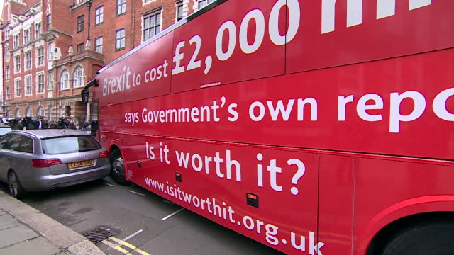 An antiBrexit bus with slogans on the side driving through Westminster