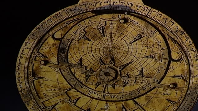 of an antique astrolabe with arabic writing. - astronomy stock videos & royalty-free footage