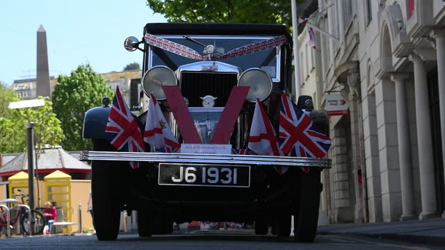 an antique car with the flags of england and jersey on the island of jersey, united kingdom on saturday, may 8, 2021 following protests by french... - 男漁師点の映像素材/bロール