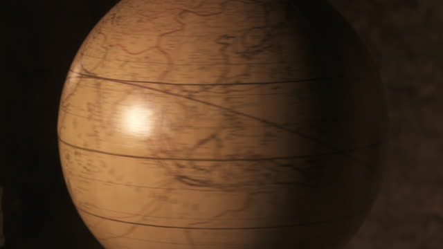 an antique globe spins.  - imagination stock videos & royalty-free footage