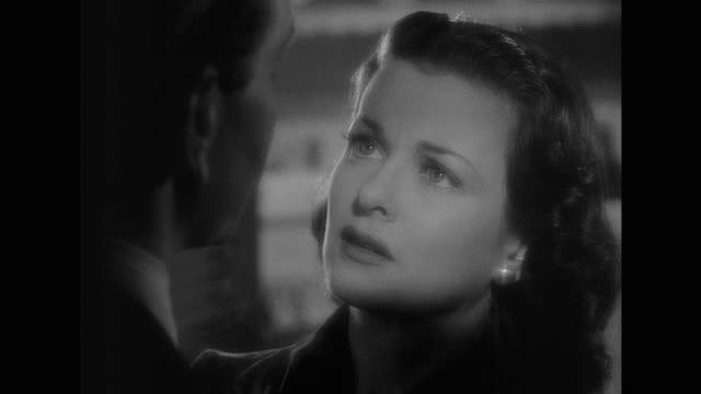 1948 CU - An anxious woman (Joan Bennett) declares her love only to have it refused by a focused man (Paul Henreid)