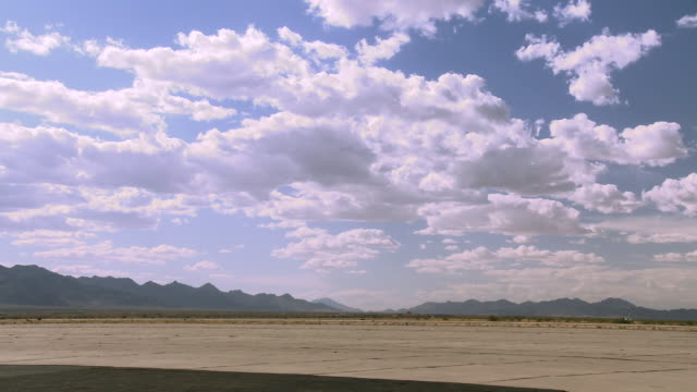 an apache helicopter waits at an air field in a desert in blythe, california. - apache helicopter stock videos and b-roll footage