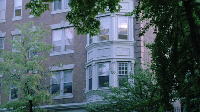 an apartment building stands in philadelphia. - bay window stock videos & royalty-free footage
