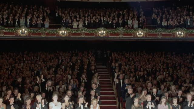 an applauding theater audience. - festlich gekleidet stock-videos und b-roll-filmmaterial