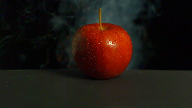 An apple exploding close-up.