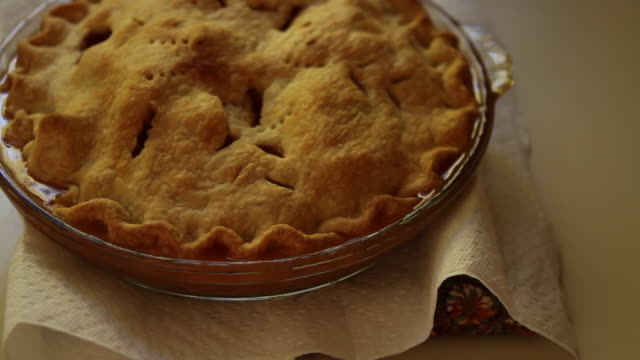 An apple pie sits on a table.
