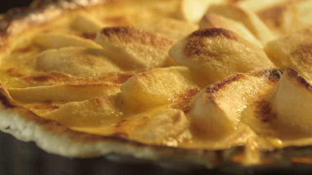 an apple tart bakes in an oven. - baked pastry item stock videos and b-roll footage