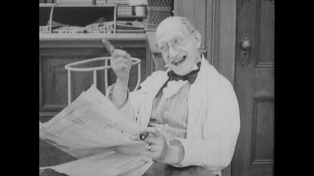 vídeos de stock, filmes e b-roll de 1917 an approving man reads a newspaper - mostrar