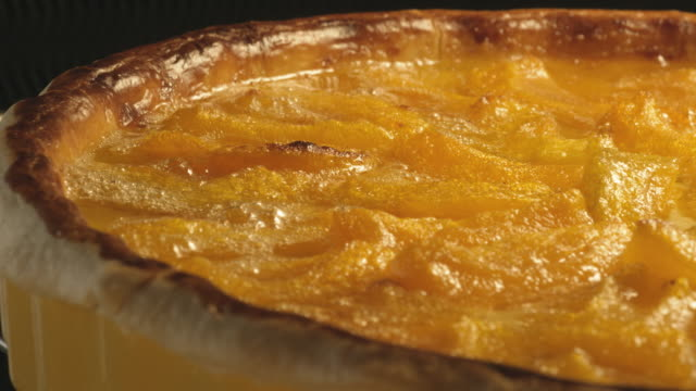 An apricot tart bakes in the oven.