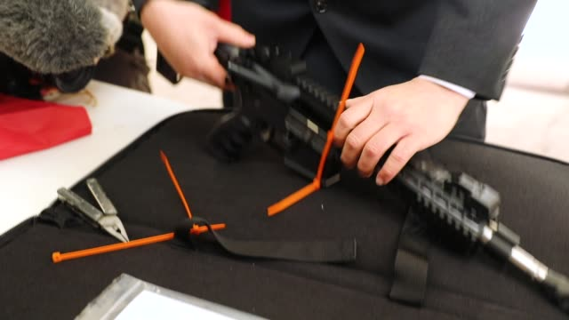 an ar15 rifle is inspected before a ceremony at the world peace and unification sanctuary in newfoundland pennsylvania on february 28 2018 in... - frieden stock-videos und b-roll-filmmaterial