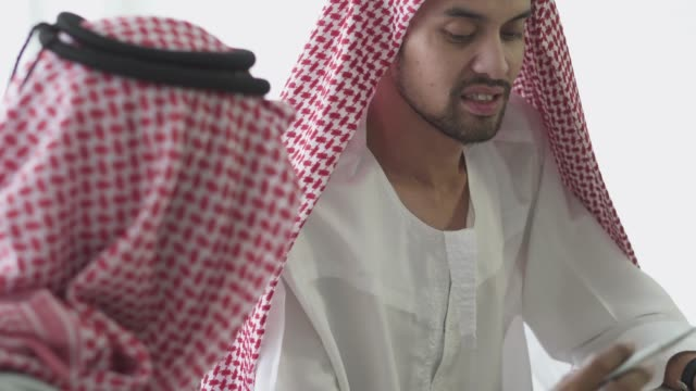 an arabian businessmen talking to each other - saudi arabia stock videos & royalty-free footage