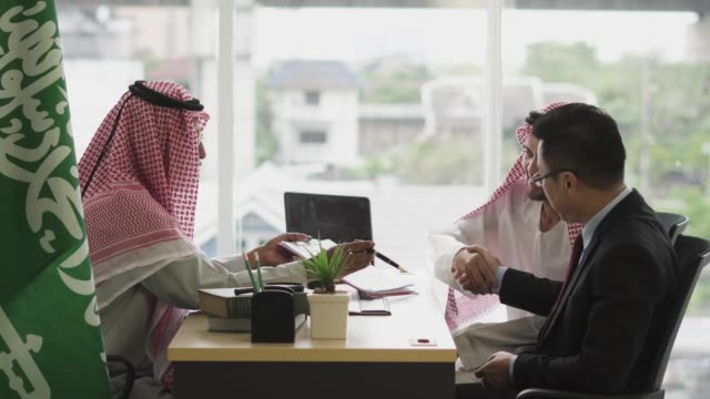 an arabic businessman having meeting with an asian businessman - middle eastern ethnicity stock videos & royalty-free footage