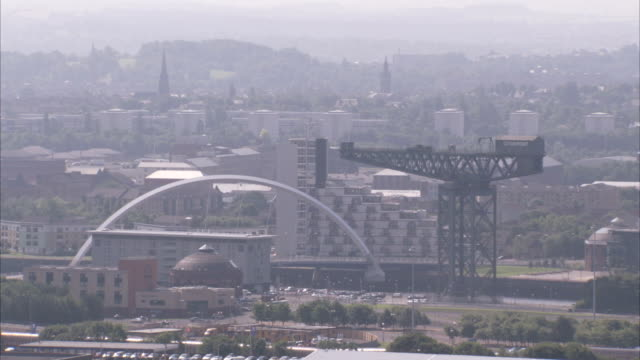 An arch spans the River Clyde and Clydeport in Glasgow Scotland Available in HD.
