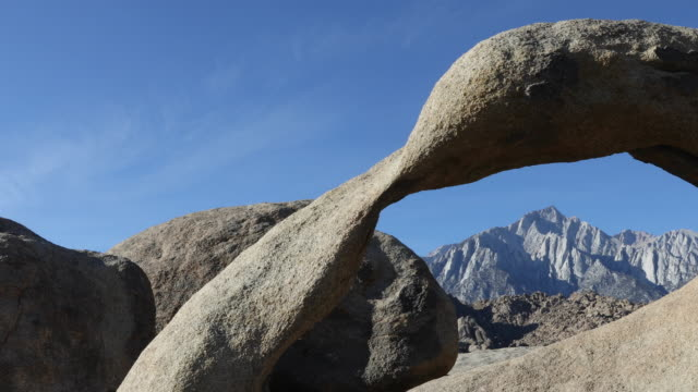 an arch with mt. whitney in the distance - californian sierra nevada stock videos & royalty-free footage