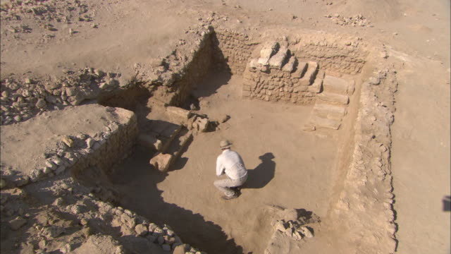 an archaeologist explores the ruins of berenike, egypt. - archaeology stock videos & royalty-free footage