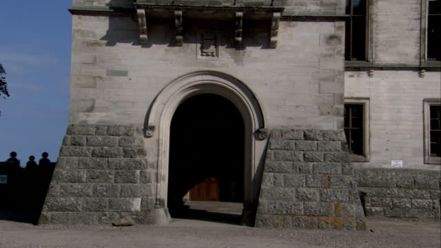 An arched doorway leads into a tower on Dunrobin Castle. Available in HD.