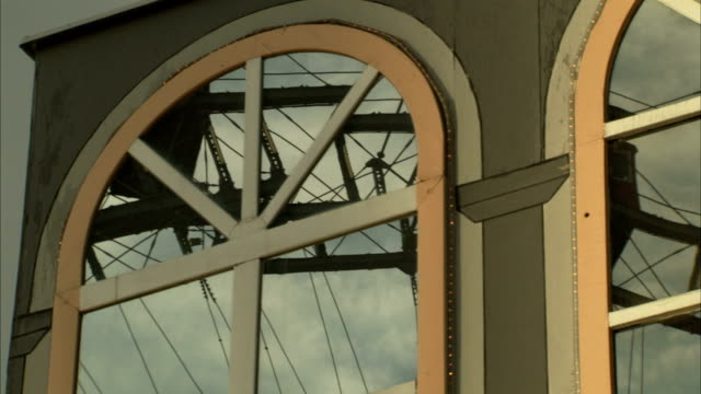 an arched window reflects a ferris wheel at the wiener prater amusement park in vienna. - prater park stock videos & royalty-free footage