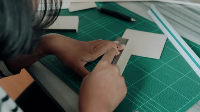 an architect working and cutting papers - stock image - architectural model stock videos & royalty-free footage