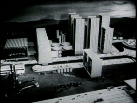 stockvideo's en b-roll-footage met an architect's model displays the plans for a futuristic city during the world's fair exhibit in queens new york city - 1964