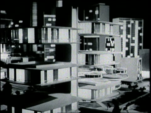 vídeos de stock, filmes e b-roll de an architect's model displays the plans for a futuristic city during the world's fair exhibit in queens new york city - 1964