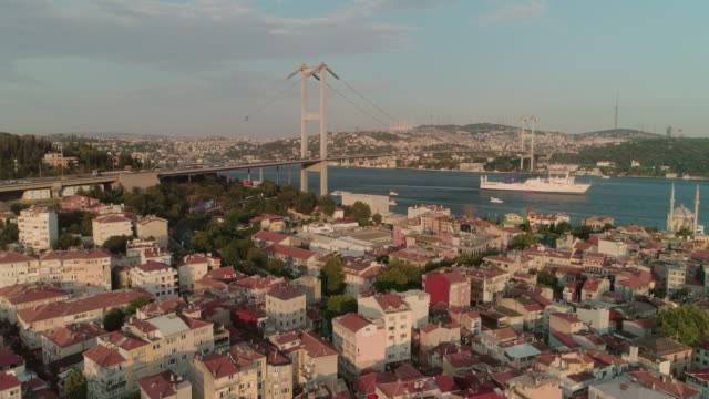 an areial view of the bosphorus bidge over istanbul rooftops. otrakoy. istanbul. turkey. - golden horn istanbul stock videos and b-roll footage