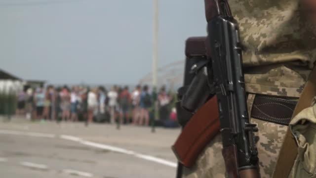 An armed guard at the UkraineCrimea border