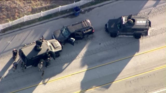 ktla an armed man and a woman suspected in a mass shooting that killed 14 people were dead after a shootout in san bernardino that also left a police... - police car stock videos & royalty-free footage