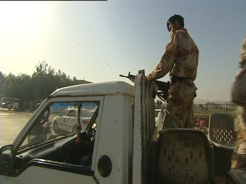 an armed man stand in a truck in karachi on election day - karachi stock videos and b-roll footage